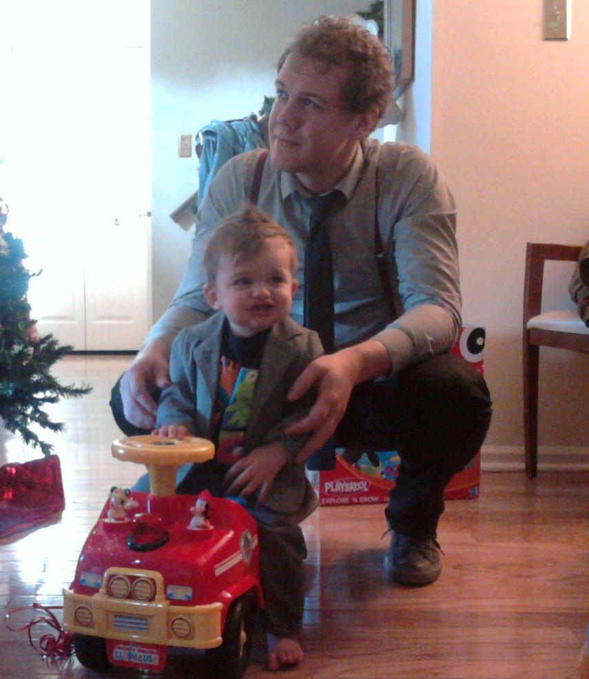 Andrew with Heath on his firetruck