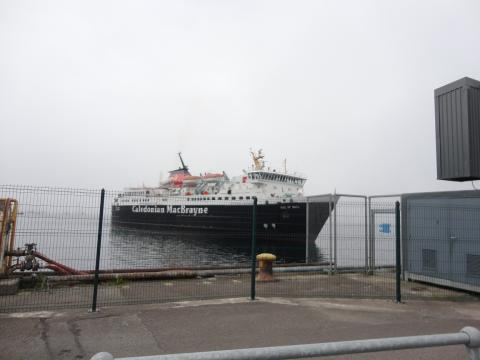 """A large ferry boat that says """"Caledonian MacBrayne"""" on the side. The boat's name on the bow reads """"Isle of Mull""""."""