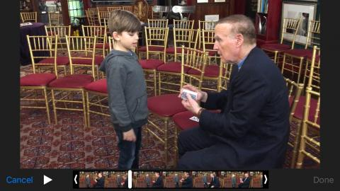 Heath talks to Magician Richard Bloch, who is sitting and holding a deck of cards